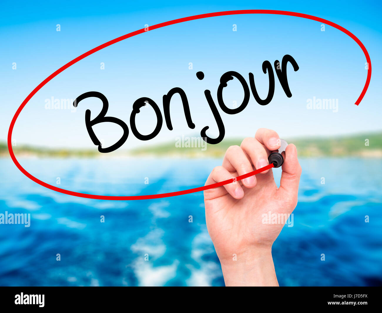 Man Hand Writing Bonjour Good Morning In French With Black Marker