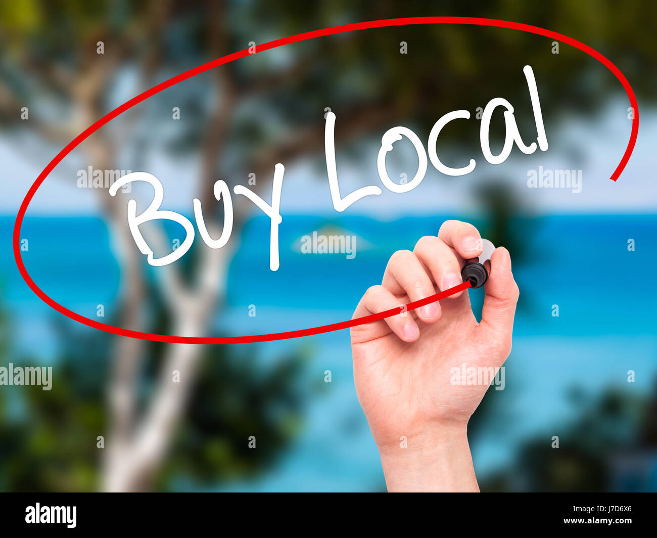 Man Hand writing Buy Local  with black marker on visual screen. Isolated on background. Business, technology, internet - Stock Image