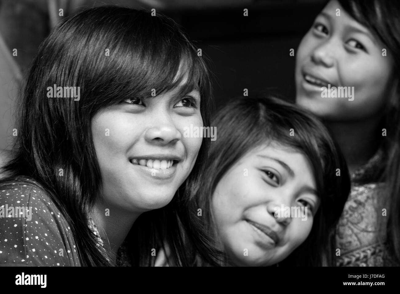 Beautiful girls from Tana Toraja ethnic minority group. Close-up face portrait in black and white. Togetherness - Stock Image