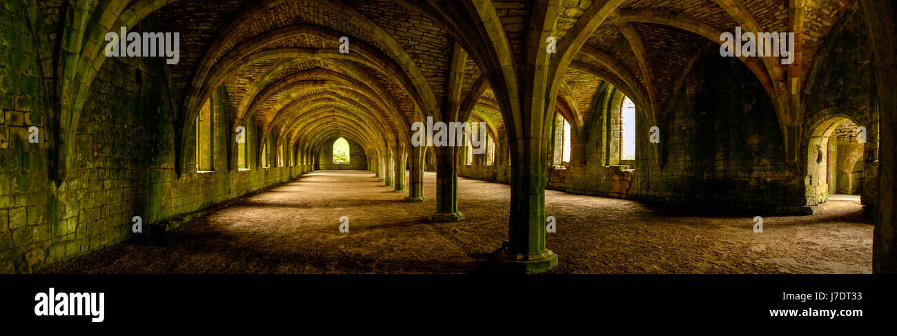 A panorama of the abandoned Celarium at Fountains Abbey in Yorkshire, under natural lighting. - Stock Image