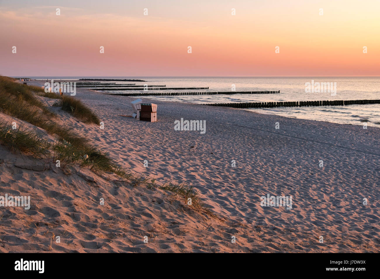Beach with beach chairs and sea groynes at Ahrenshoop, Mecklenburg-Vorpommern, Germany - Stock Image