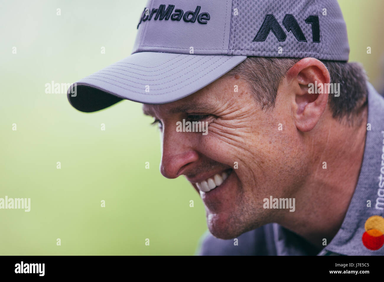 Justin Rose enjoys the Pro-Am competition ahead of the BMW PGA Championship at Wentworth on May, 24, 2017. - Stock Image