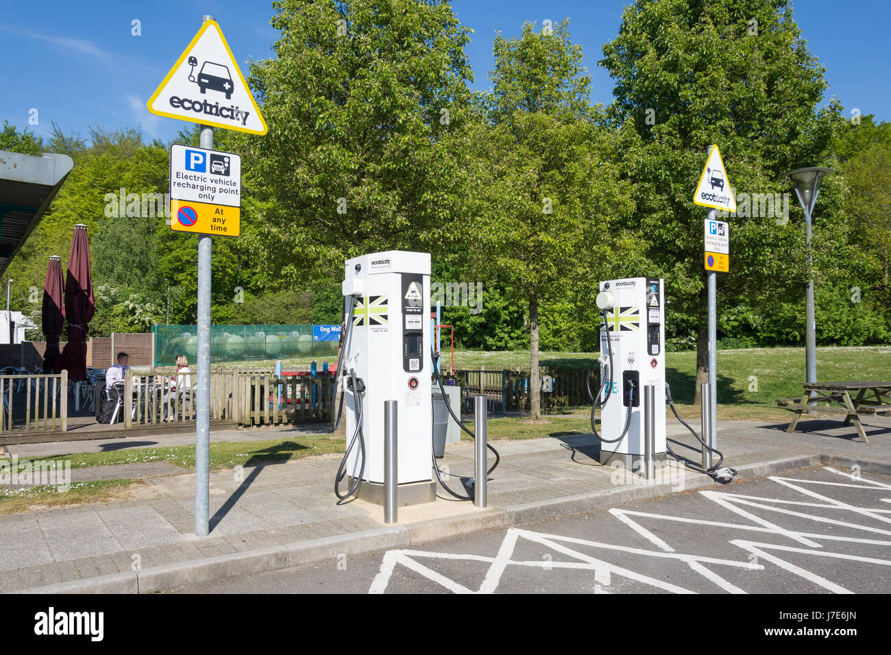 Ecotricity auto electric charger terminals, Winchester M3 Motorway Services, Winchester, Hampshire, England, United - Stock Image