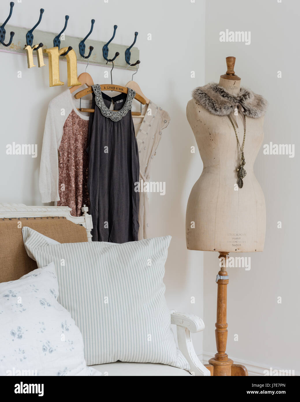 Picture of: Elegant Mannequin In Bedroom With Rustic Coat Hooks And Cushions From Stock Photo Alamy