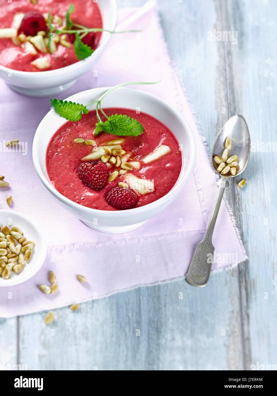 Tomato raspberry smoothie bowl - Stock Image