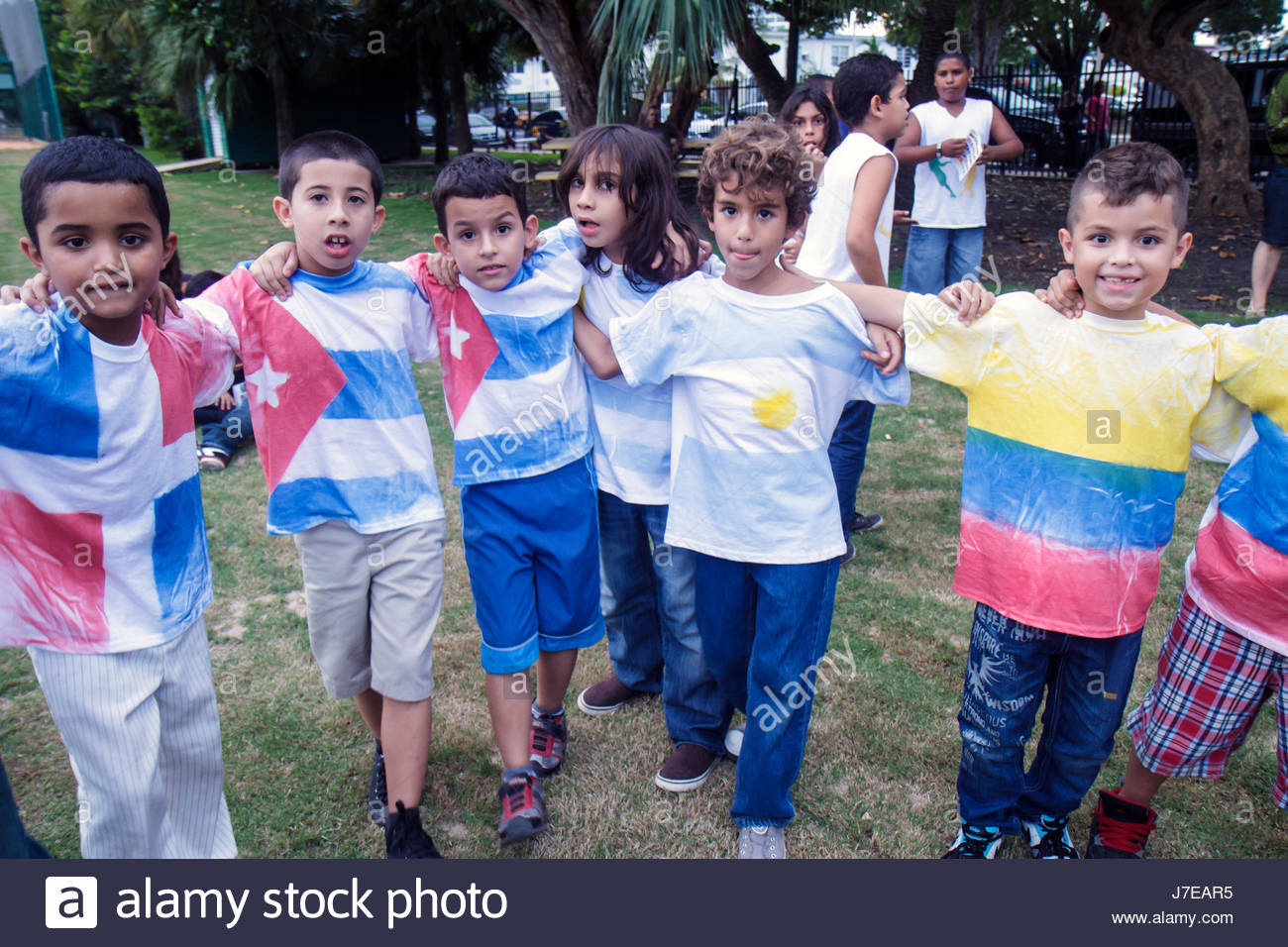 Miami Beach Florida North Beach Northshore Park Hispanic Heritage Festival boy group friends practice dance performers - Stock Image
