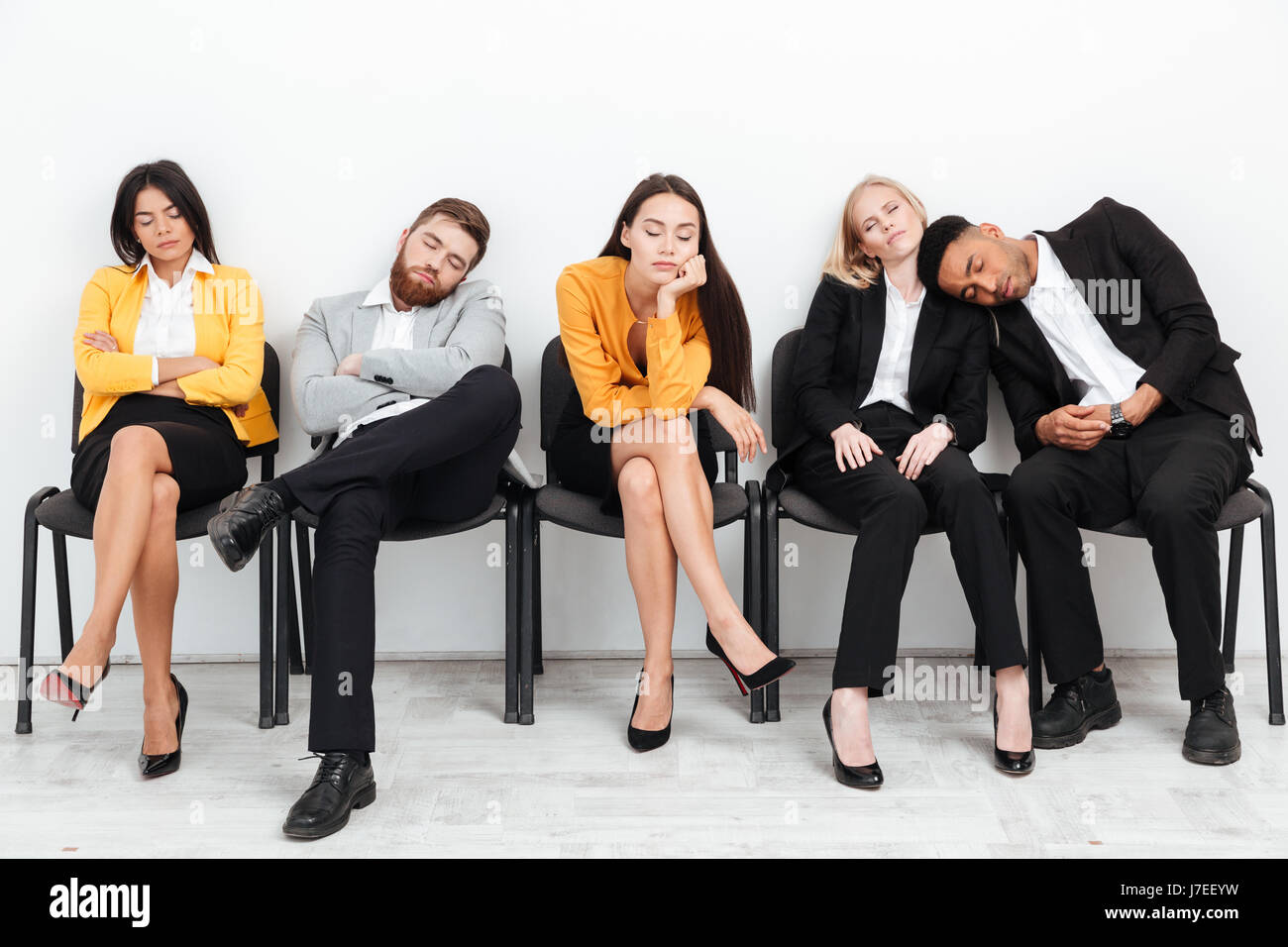 image of a group of tired colleagues sitting in office while stock