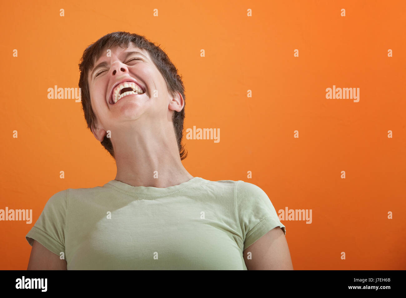 single game tournament play playing plays played feminine female one young - Stock Image