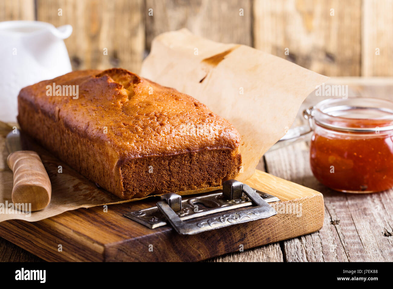 Homemade pound cake on baking paper served with fruit jam ready to eat on rustic wooden table, delicious brunch Stock Photo