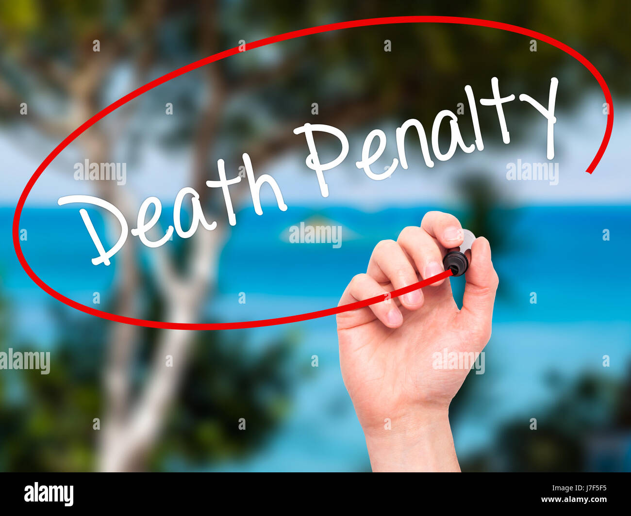 Man Hand writing Death Penalty with black marker on visual screen. Isolated on background. Business, technology, - Stock Image