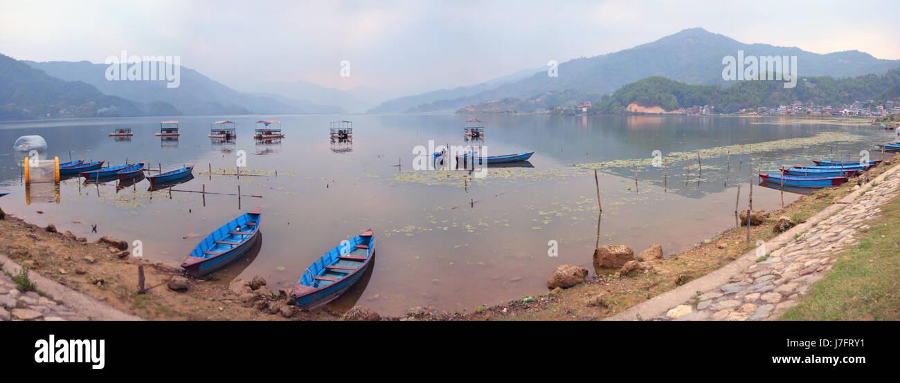 Panorama of lake Phewa and boats in Pokhara - Stock Image