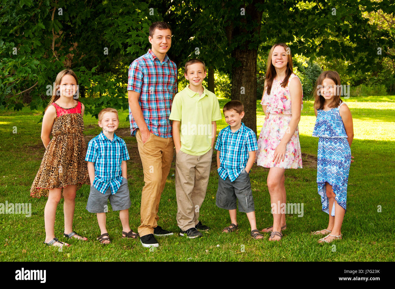 Seven siblings portrait - Stock Image
