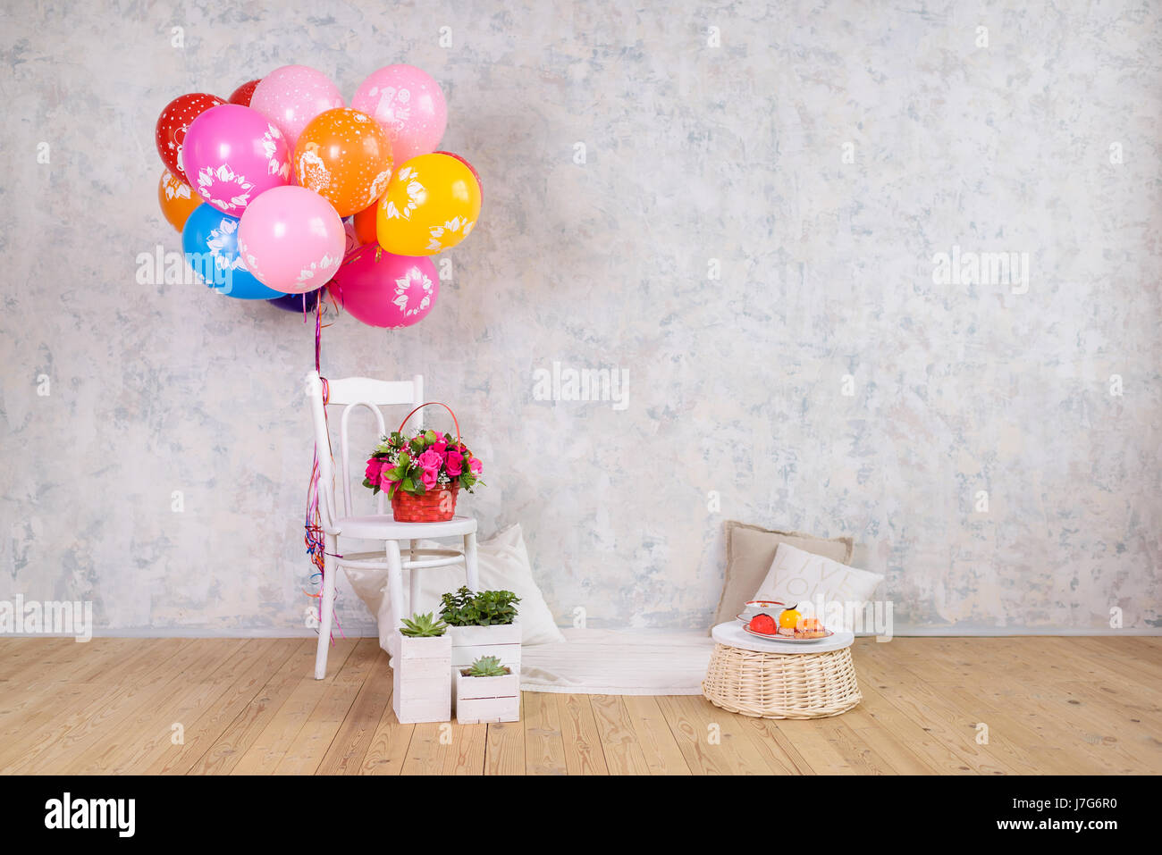 Chair and balloons flowers basket and cake birthday stock photo chair and balloons flowers basket and cake birthday izmirmasajfo
