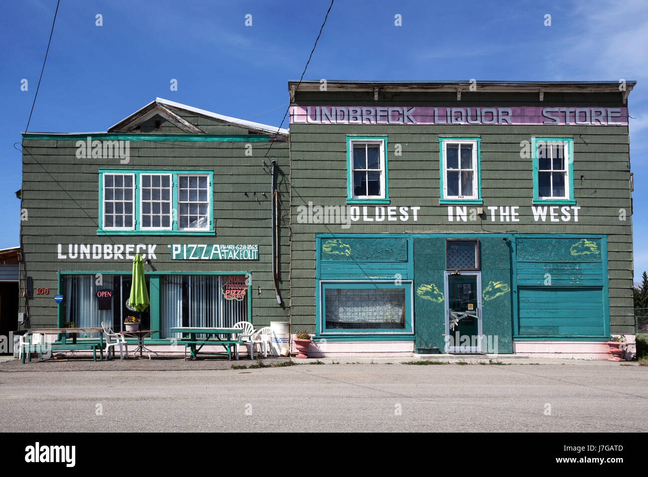 Restaurant, pizzeria, typical house with wooden facade, Lundbreck, Alberta, Canada - Stock Image