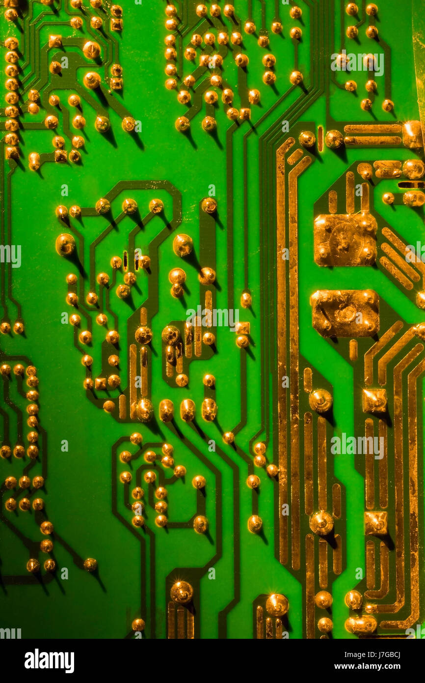 green and gold computer circuit board close up, studio compositiongreen and gold computer circuit board close up, studio composition