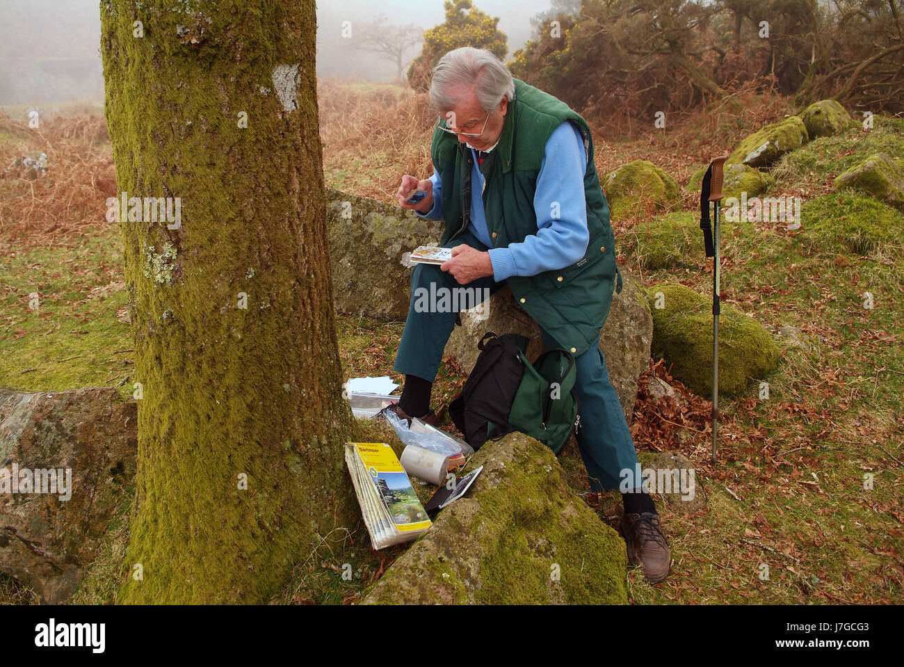 LETTERBOXING   Godfrey Swinscow at Shipley Bridge, Dartmoor showing letterboxes and the stamps from the locations Stock Photo