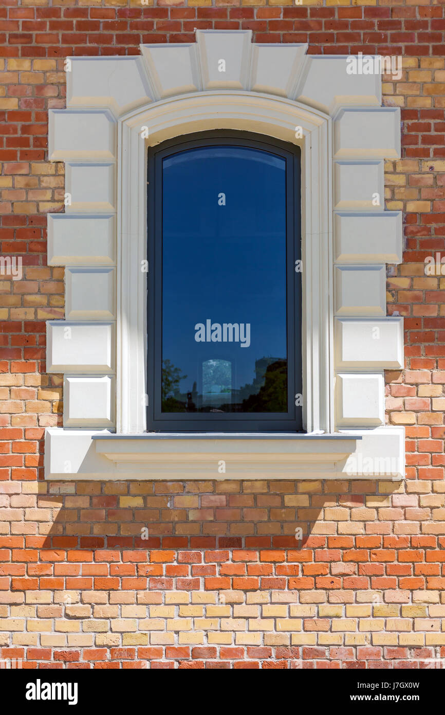 Window in a red brick wall - Stock Image