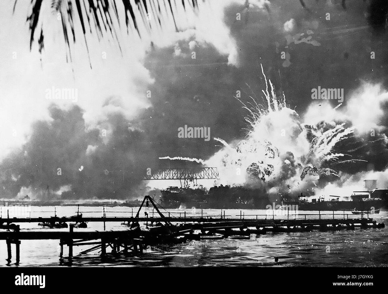 USS SHAW destroyer exploding when her forward ammunition magazine was set on fire during the Pearl Harbour attack - Stock Image