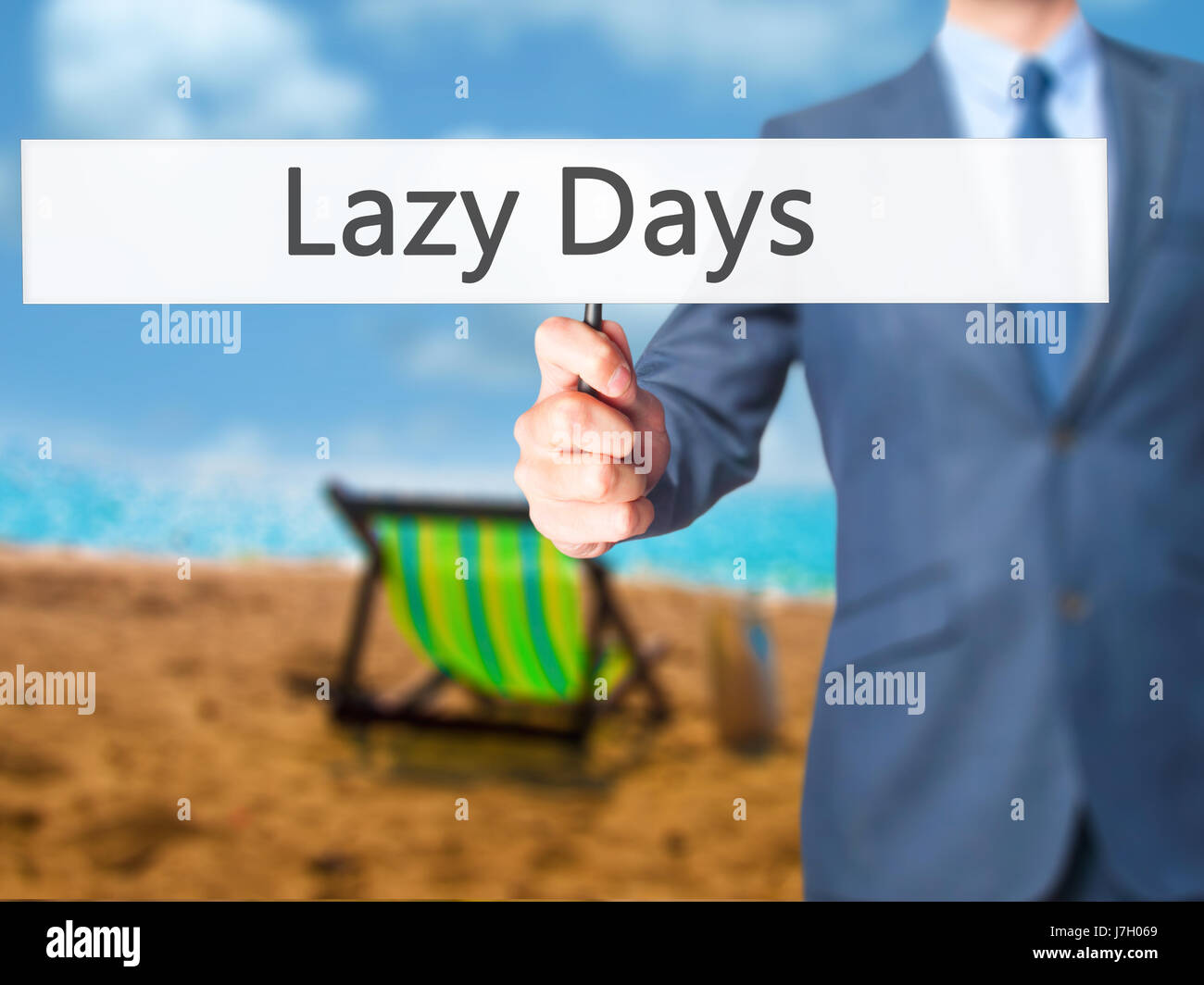 Lazy Days - Businessman hand holding sign. Business, technology, internet concept. Stock Photo - Stock Image