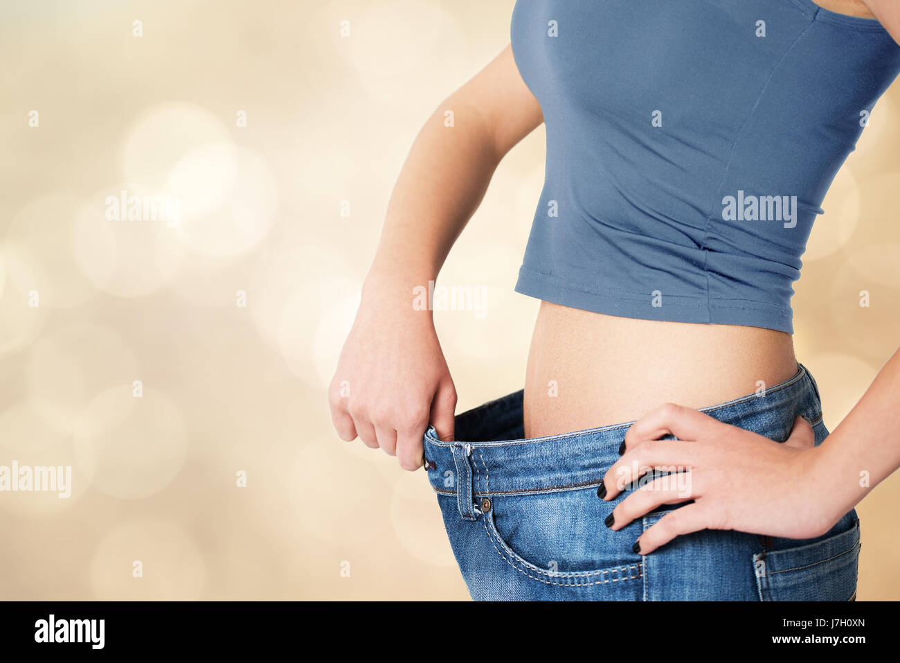 Thin woman in big pants - weight loss concepts - Stock Image