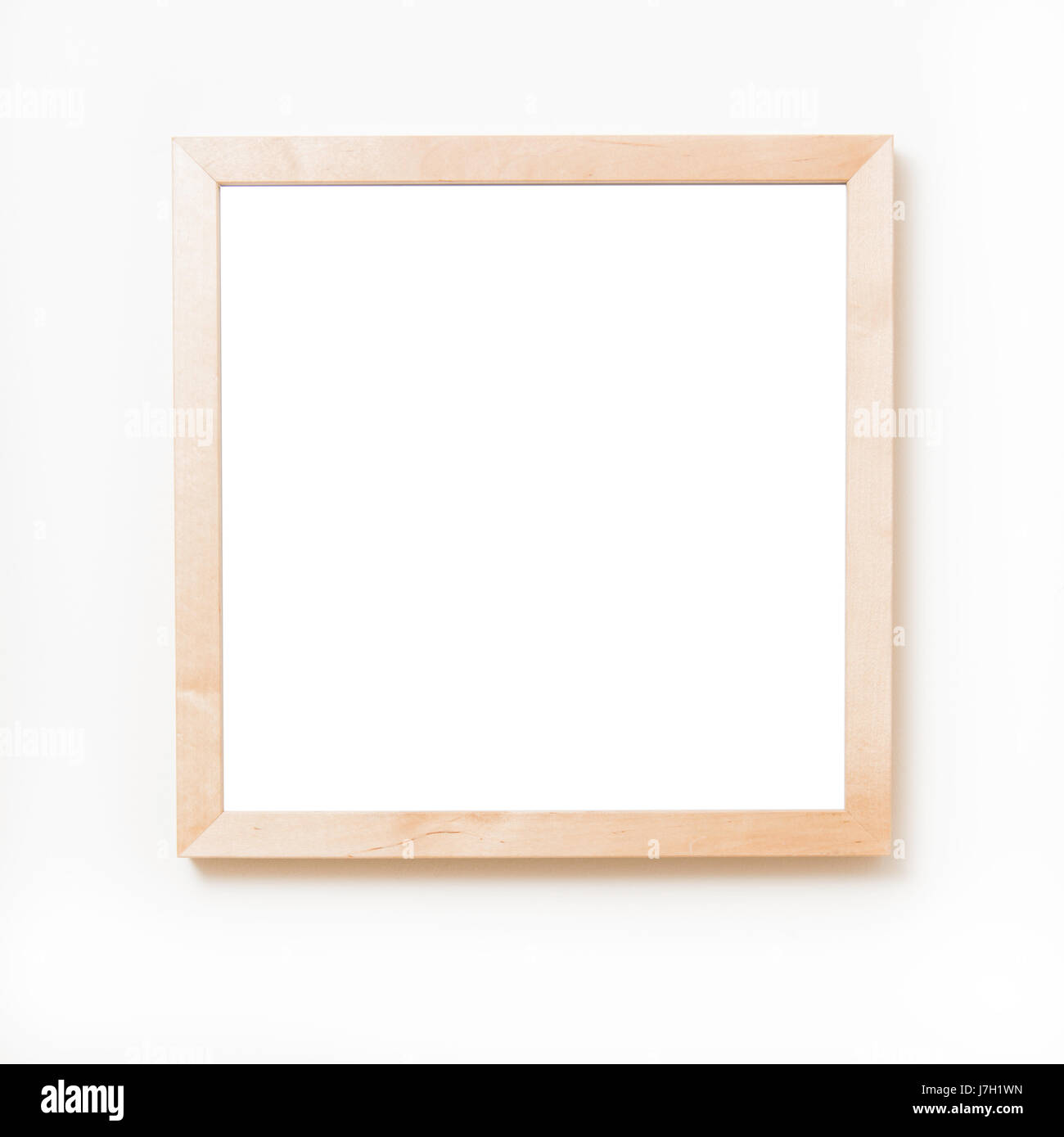 Blank square wooden frame hanging on a white wall Stock Photo ...