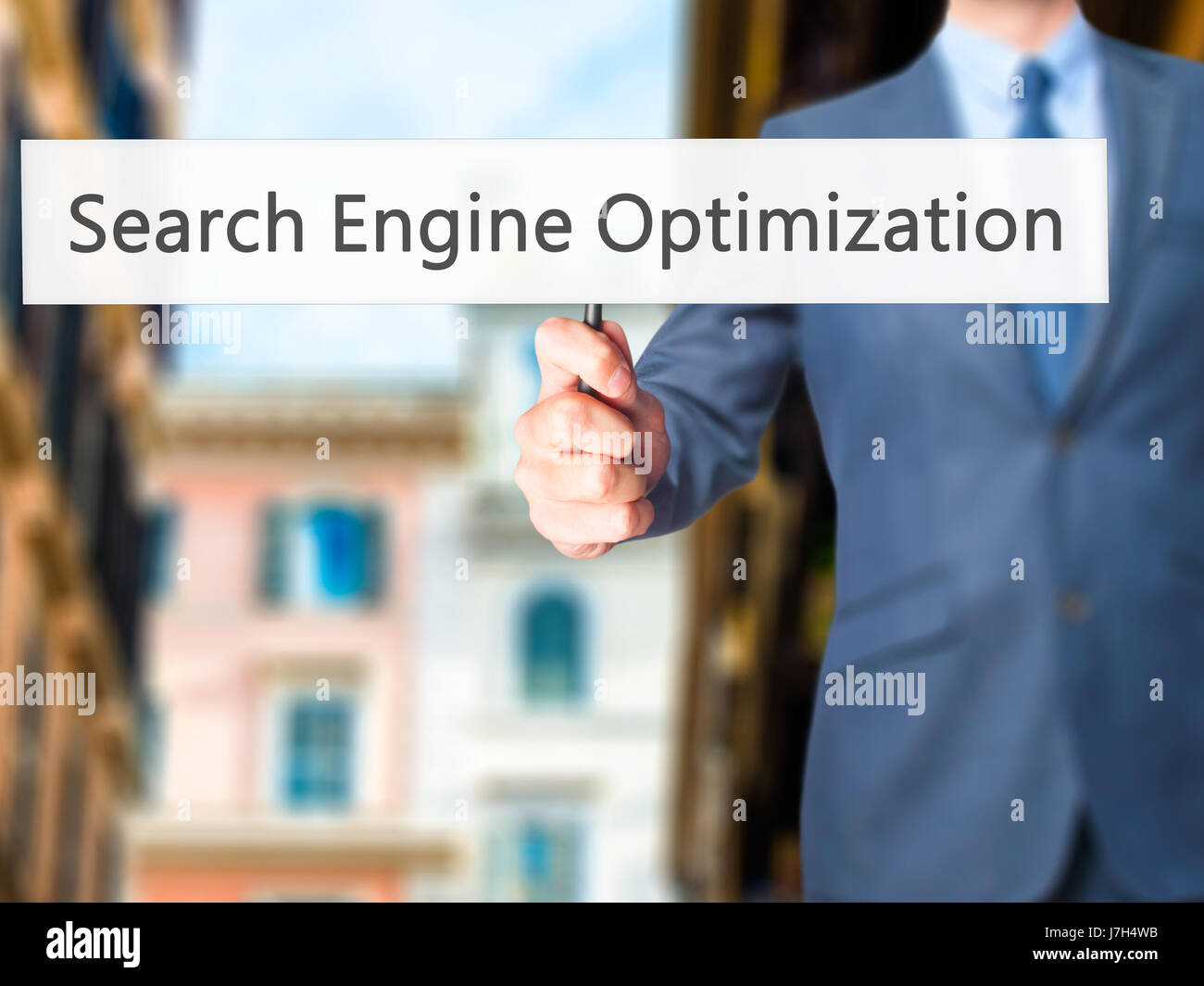 Search Engine Optimization - Business man showing sign. Business, technology, internet concept. Stock Photo Stock Photo