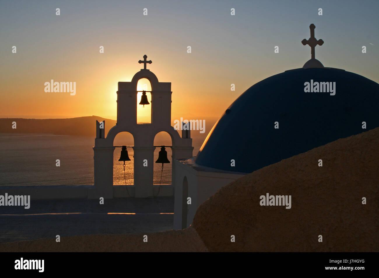 house building church sunset greece water mediterranean salt water sea ocean - Stock Image