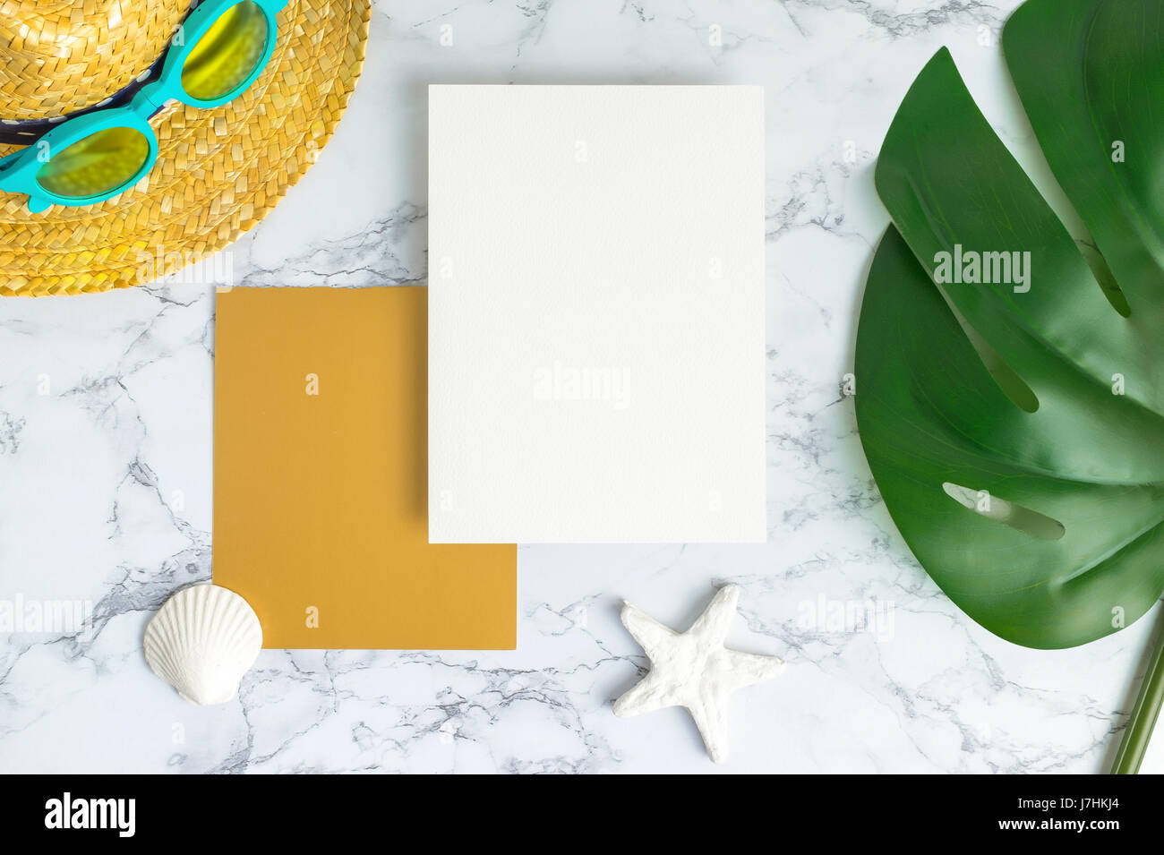 Blank White And Gold Paper Card On Marble Table Top View With Summer Beach  Accessories And Shell,starfish,tropical Palm Leaves ,Summer Vacation Concep