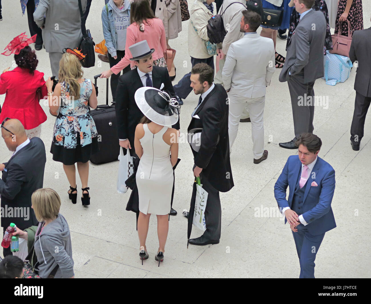 Waiting for a train to the Ascot races at Waterloo Station London - Stock Image