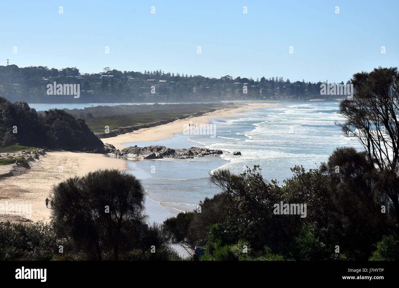 People walking on the beach at Blackfellows Point. Potato Point is a village in the Eurobodalla Shire lying on the - Stock Image