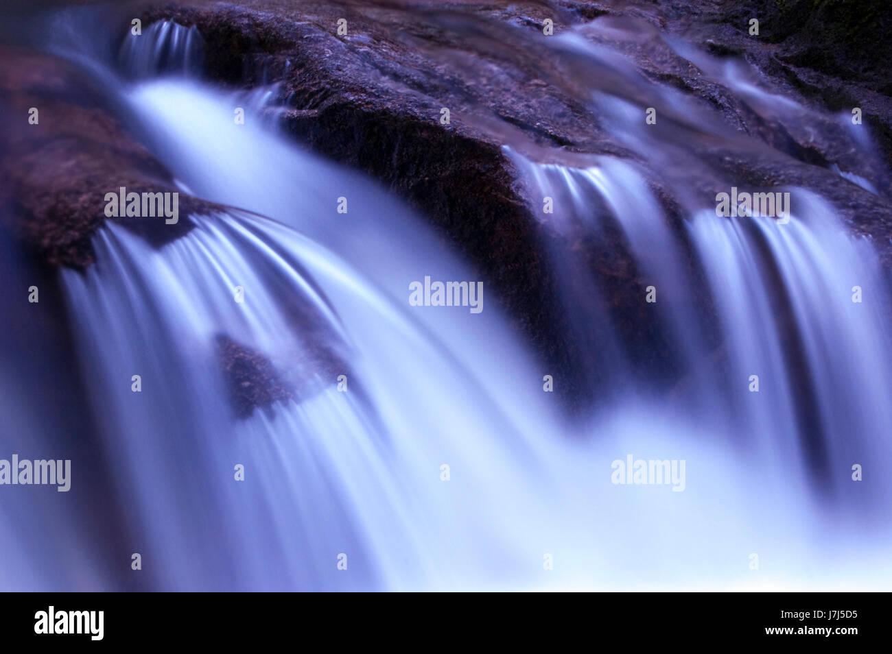 blue motion postponement moving movement shine shines bright lucent light - Stock Image