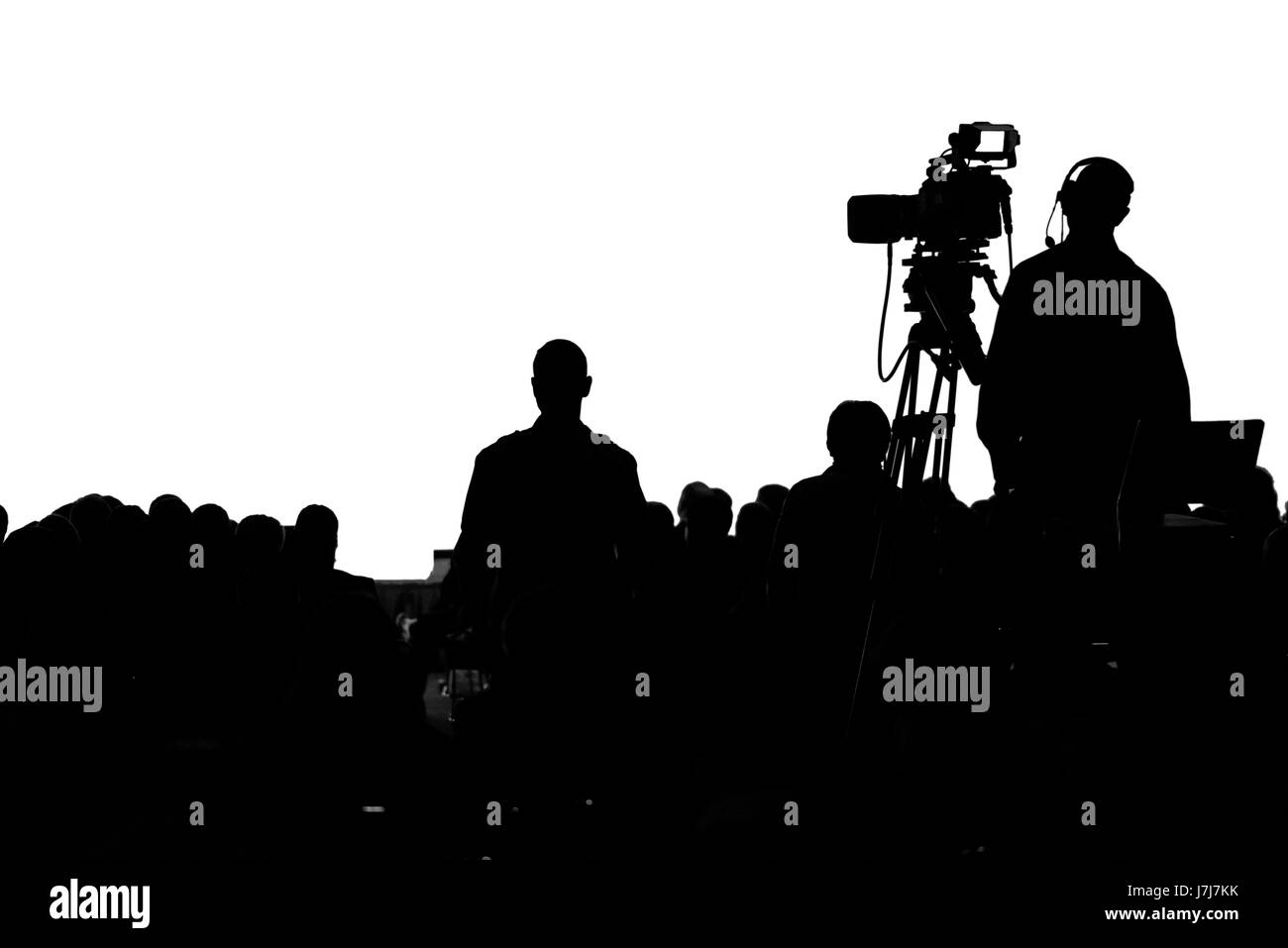 Television Press Conference production cameraman silhouette - Stock Image