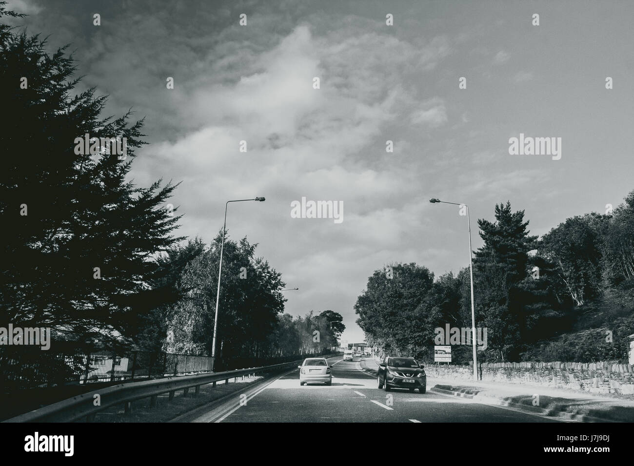 Shot of the highway leading towards the killarney national park with a dramtic sky in the depth. - Stock Image