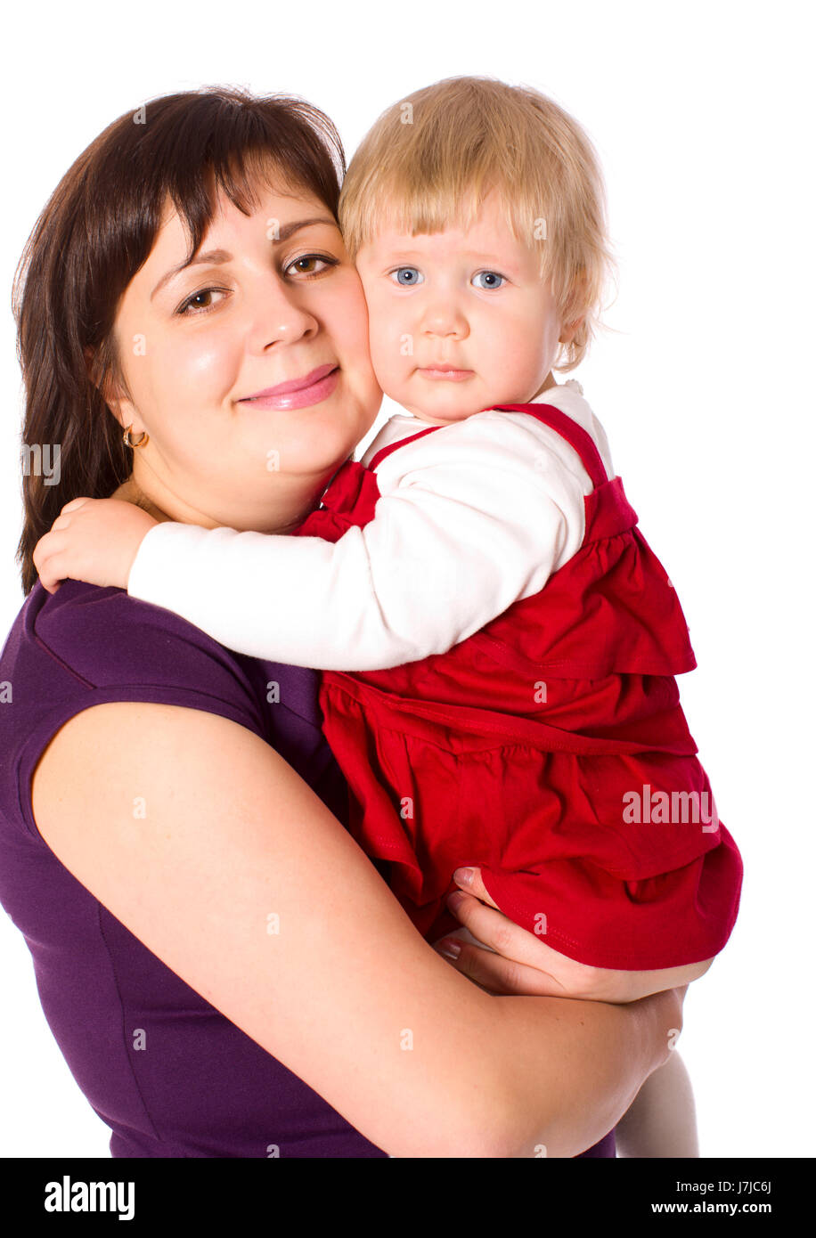 Happy mother holding tight one year daughter isolated on white Stock Photo