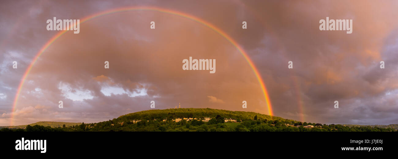 Double rainbow over Bathampton. Panorama of countryside on outskirts of Bath, UK, following heavy May showers - Stock Image