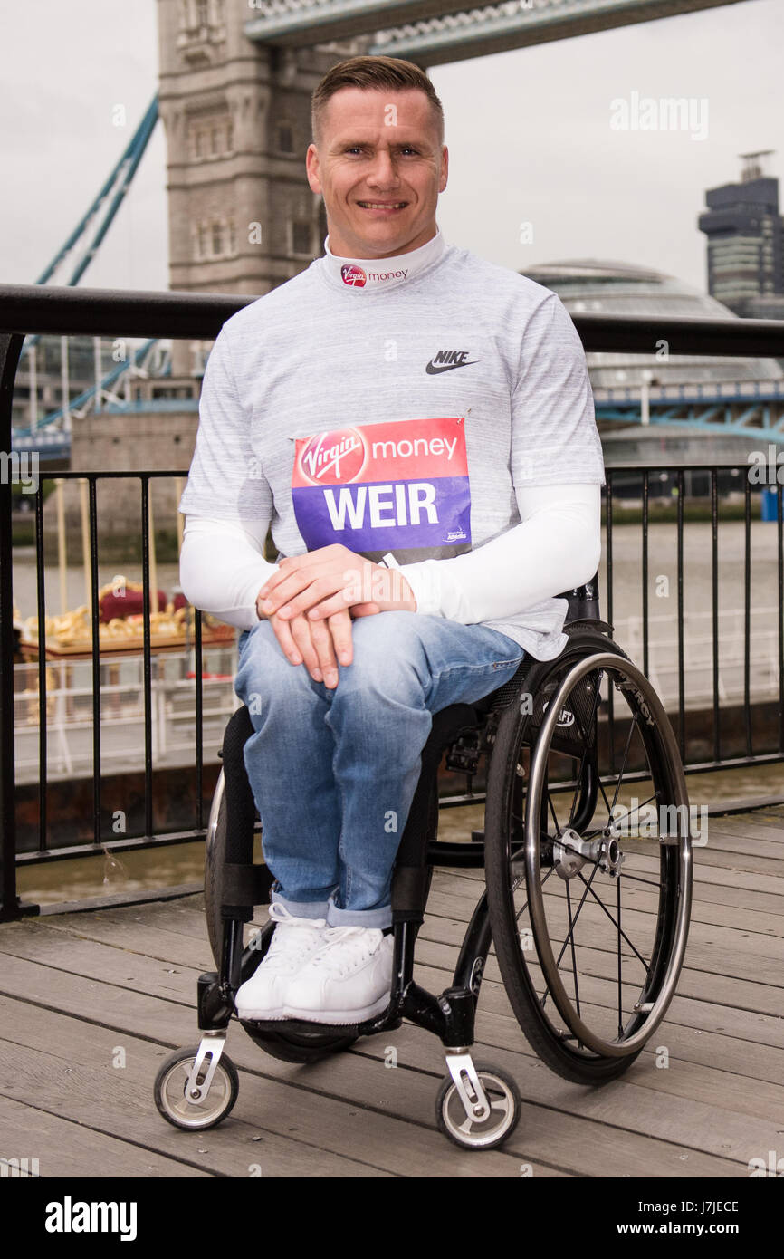Winners of the mens and womens elite race and mens wheelchair elite pose for photos the day after the London Marathon Stock Photo