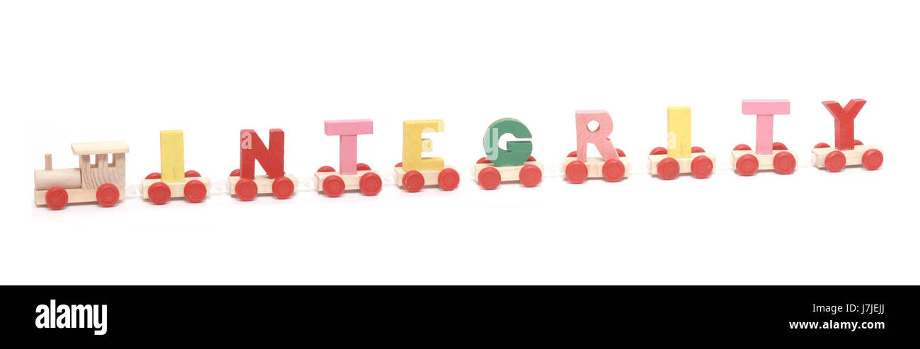 The sense of integrity,interdependance and togetherness is shown with train formed from letters with each letter - Stock Image