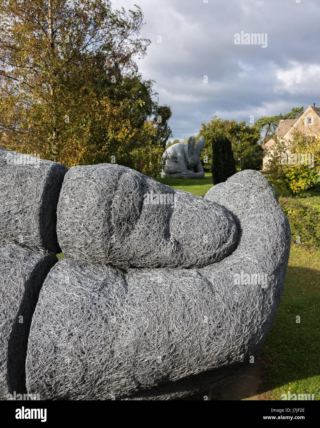 Large sculpture of a hand by Sophie ryder on garden lawn - Stock Image