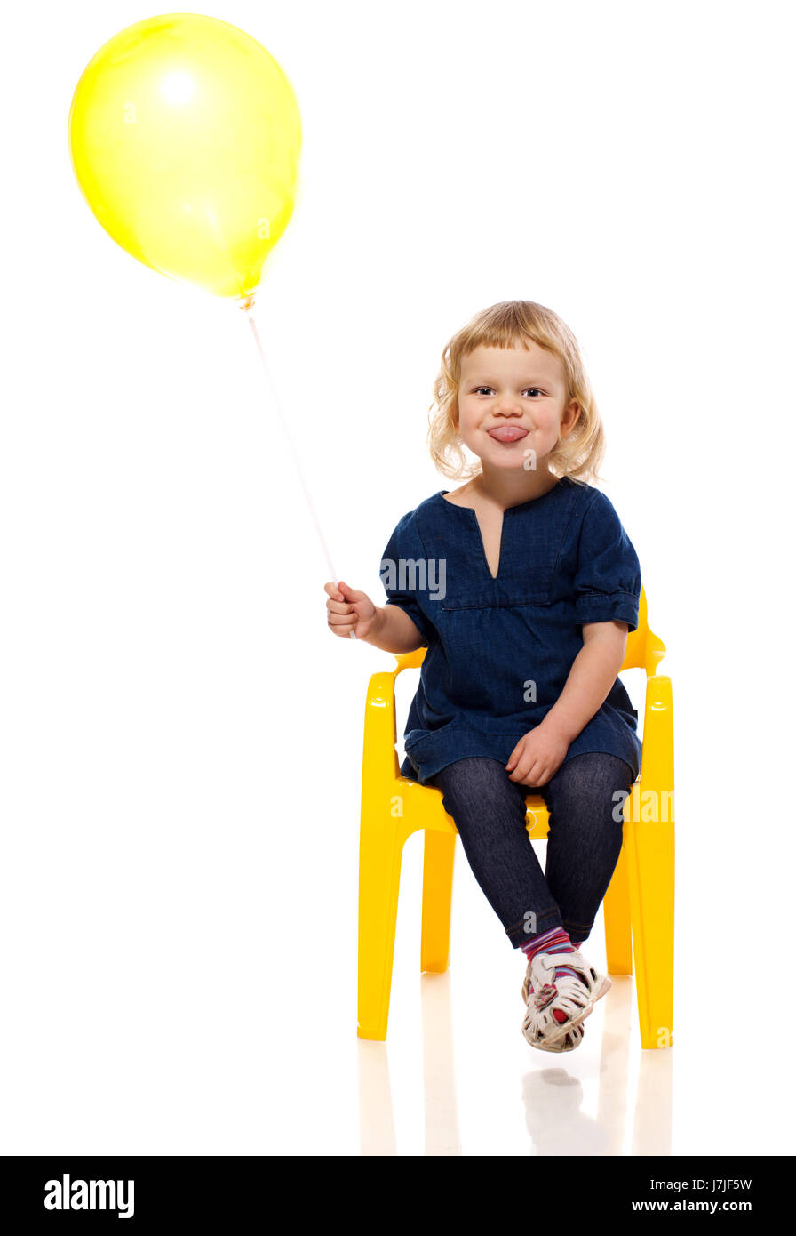 Funny Girl holding balloon making faces isolated Stock Photo