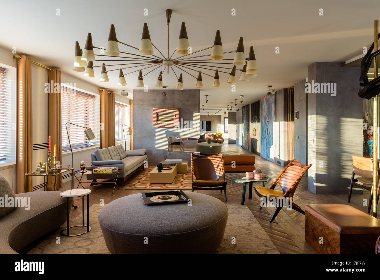 Seating area with 1950s style lights in 30 metre living space of Istanbul apartment - Stock Image
