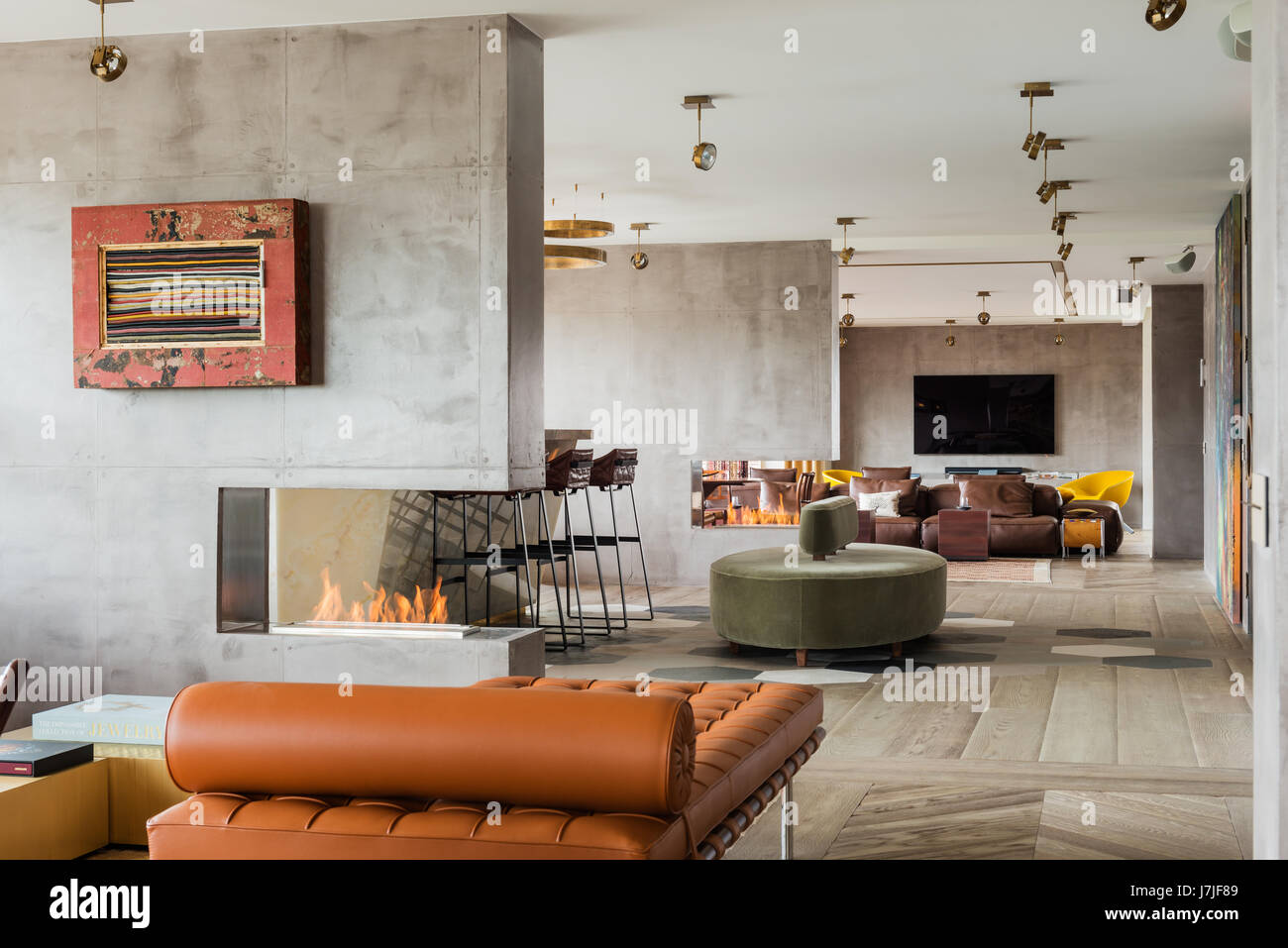 Pair of brown leather chairs in spacious 30 metre open plan living area - Stock Image