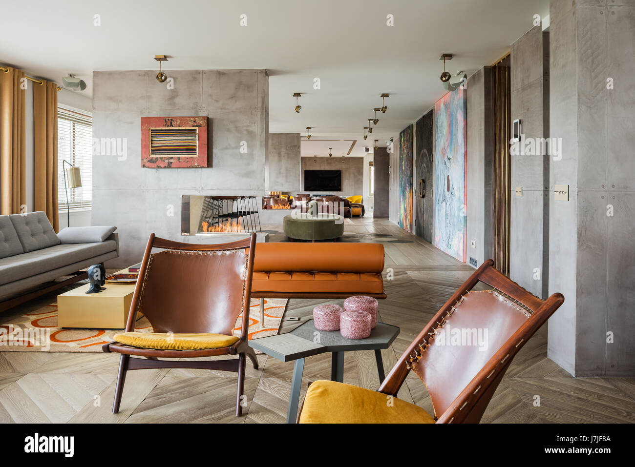 Pair of brown leather, vintage Sadler chairs in 30 meter open plan living space - Stock Image