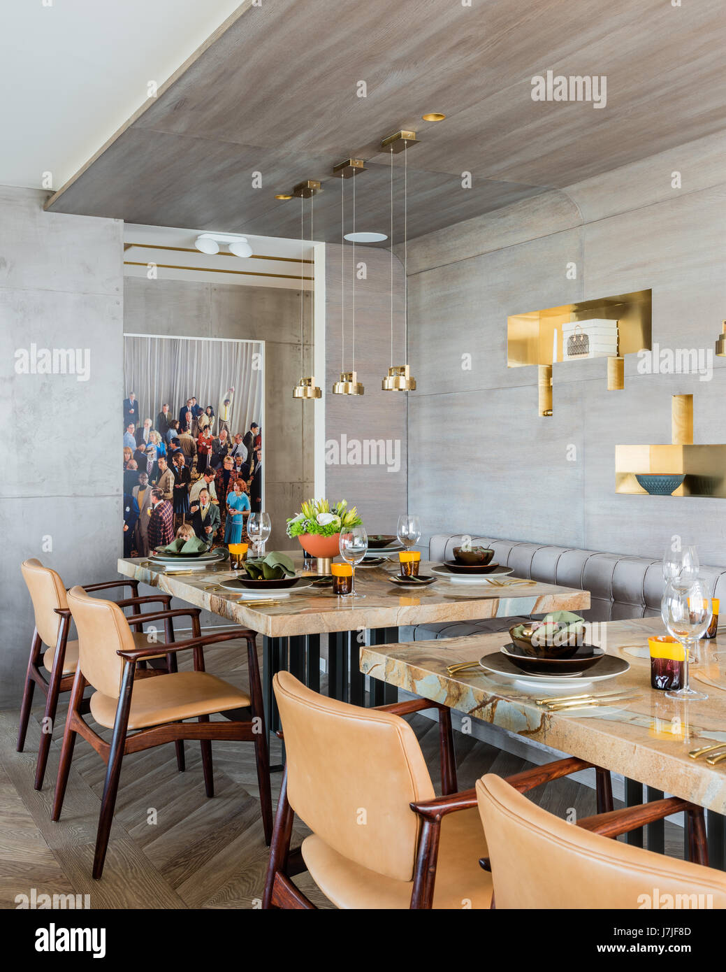 Laura Meroni brass hanging lights above custom made stonewood marble dining tables with photographic work by Alex Stock Photo
