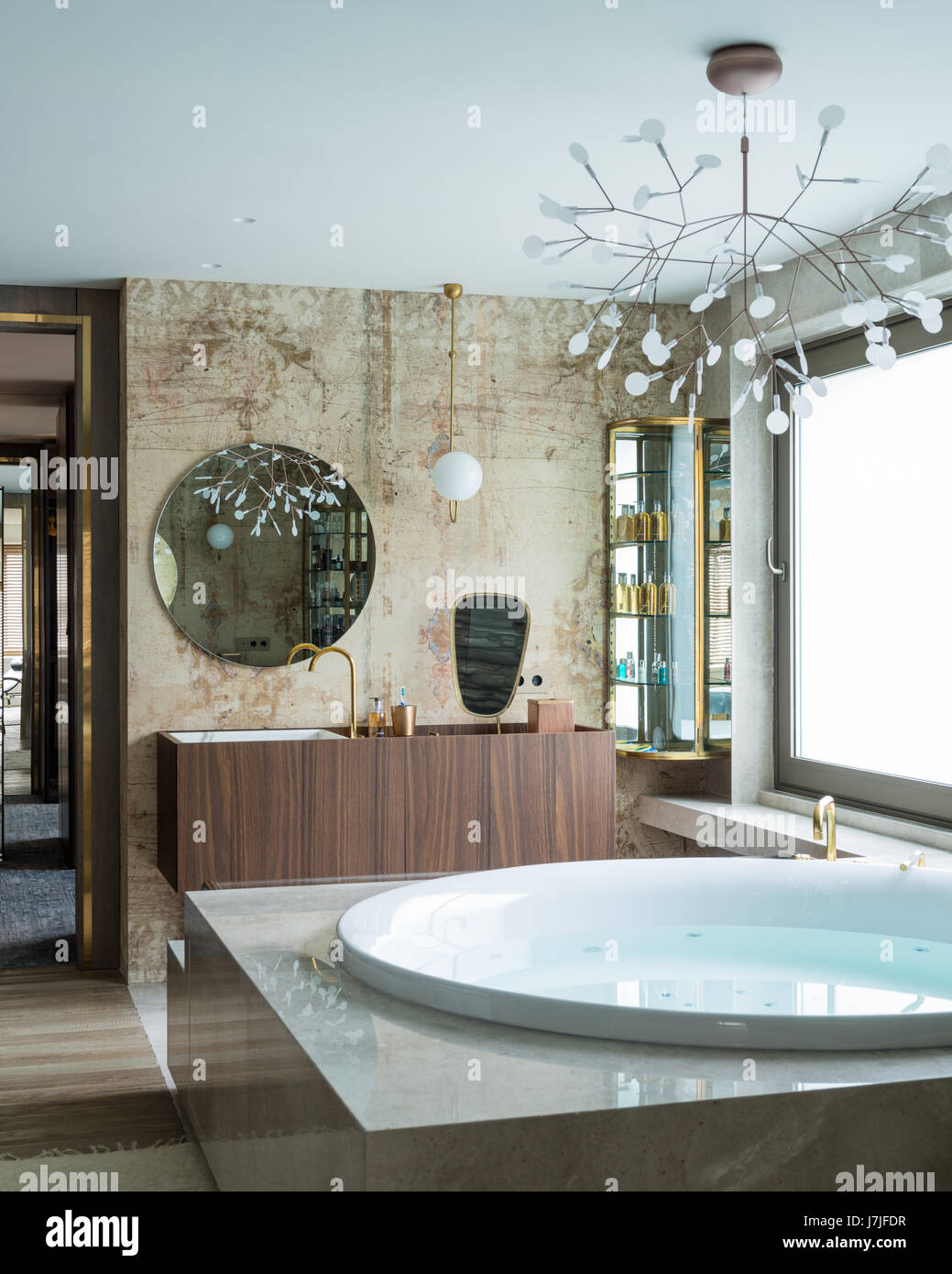 Sculptural light fitting above hot tub with frosted glass window - Stock Image