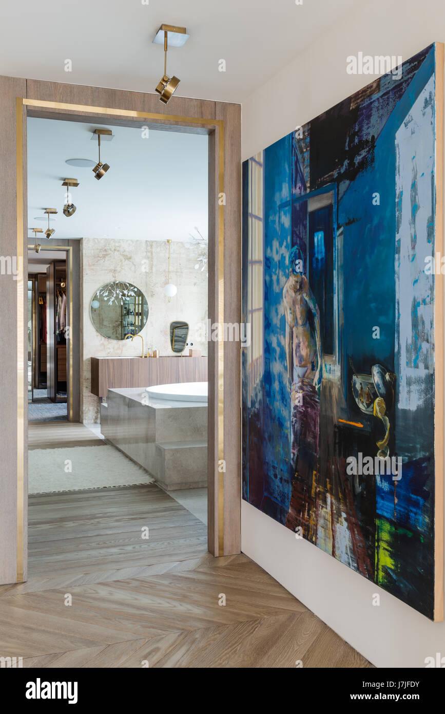 Painting by Olivier Masmonteil with bathroom beyond doorframe - Stock Image