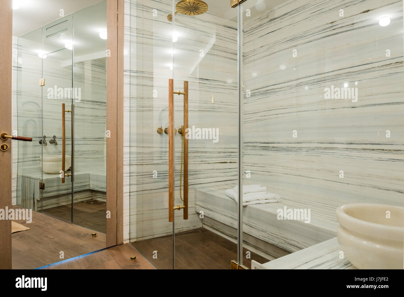 Marble lined spa with glass screen - Stock Image