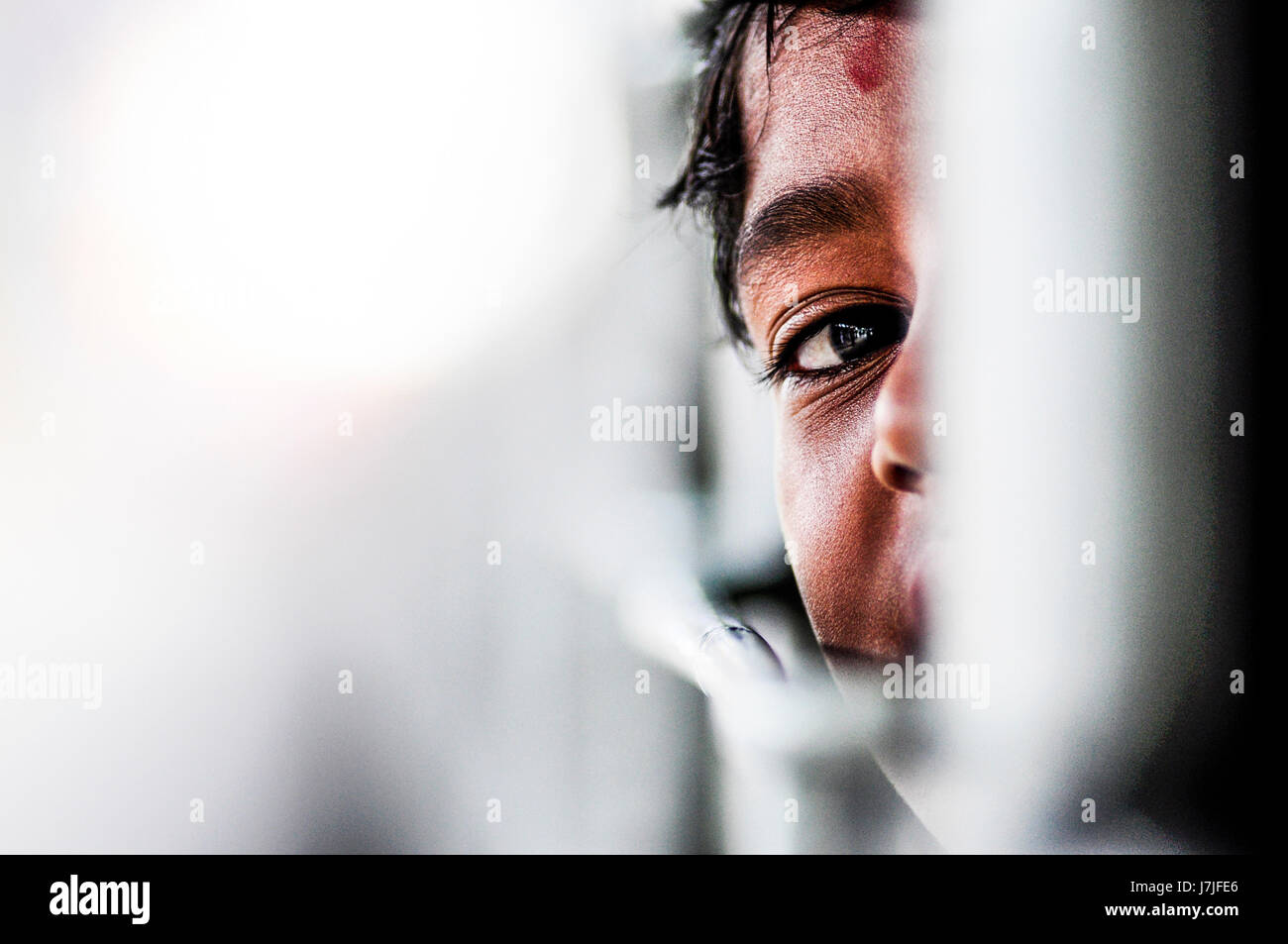 Pathankot, India, september 9, 2010: Indian kid playing hide and seek on a train in India. Stock Photo