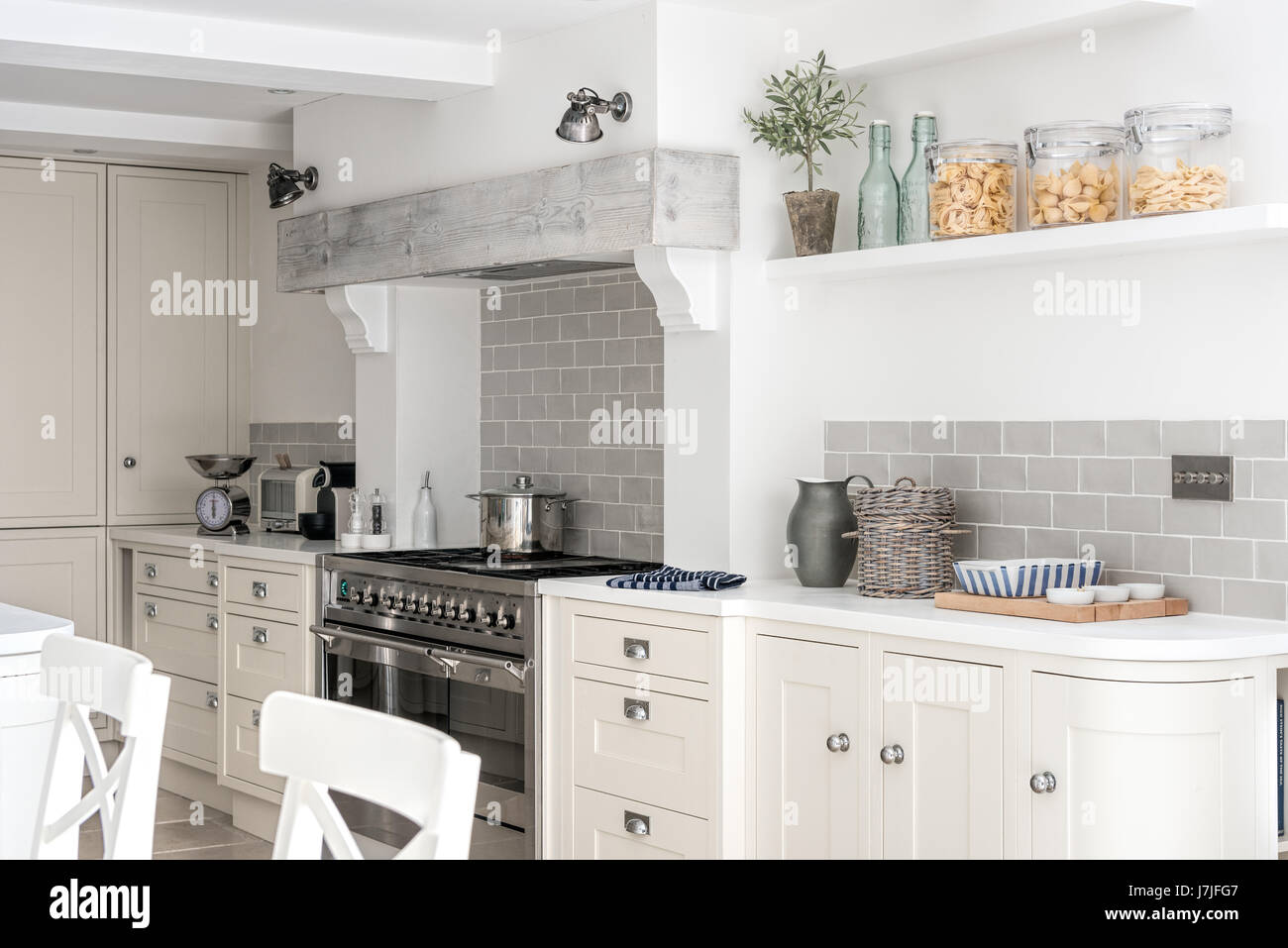 Whitewashed beam above range cooker in spacious kitchen. The tiles ...