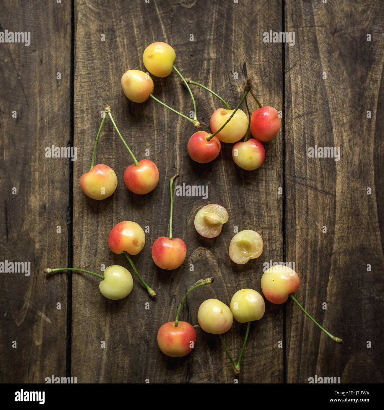 Cherries on a rustic  table, from above - Stock Image