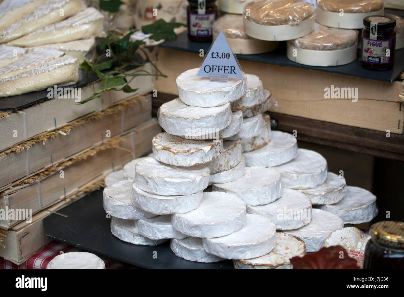 LONDON, UK - APRIL 22, 2017: Normandy Camembert and Couer de Neufchatel cheeses for sale - Stock Image